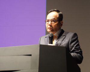 オカドとの提携により世界代表する小売業へ成長したいと話す岡田社長