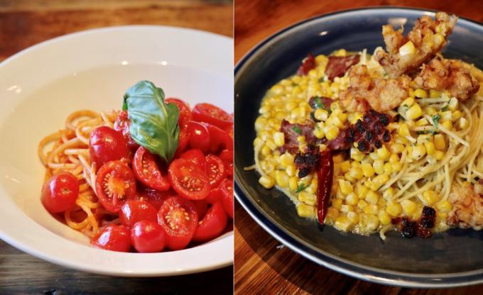 左は「厳選トマトが美味いから!スパゲティ」、右は「山梨・大塚さんのとうもろこしでパストラミ・ペペロンチーノ スパゲティ」(期間限定)。見た目、味ともにインパクトのあるパスタメニューを数多く提供する