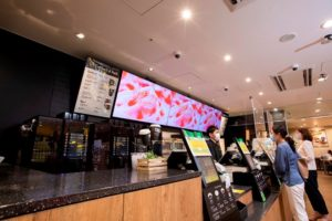 ファミマの新会社の店頭に設置したデジタルサイネージ